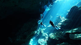 Scuba diving Chac Mool cenote in Playa del Carmen Mexico, divers enjoy beautiful light, perfec for pictures.