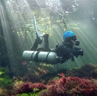 Sidemount diver in the Caves of Cozumel Mexico, ready to go cave diving.