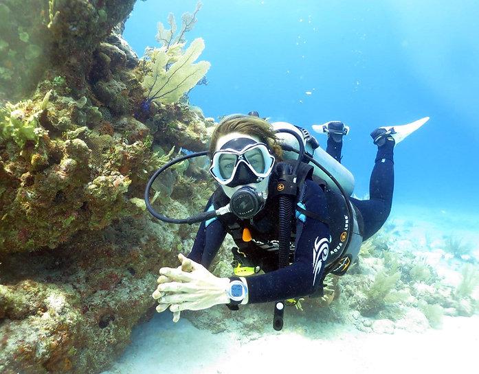 A scuba diver who got her scuba certification in Playa del Carmen