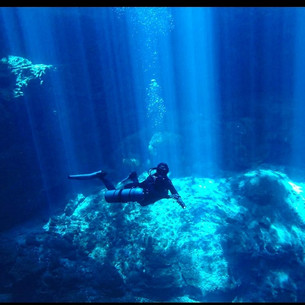 Get Wet dive shop instructor scuba diving in cenote The Pit near Tulum