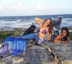 Get wet dive shop staff in mermaid costumes on the beach between Playa del Carmen and Tulum