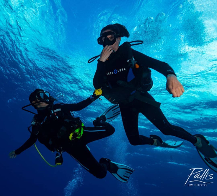 A girl discovers scuba diving with Get Wet dive instructor Karina in Playa del Carmen