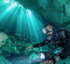 A scuba diver in Cenote Garden of Eden near Playa del Carmen, Mexico, in the Riviera Maya.