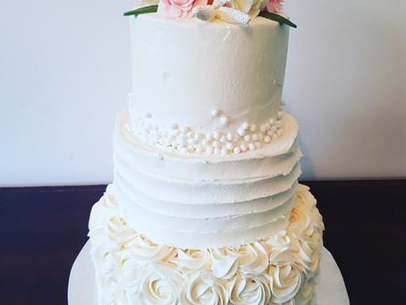 Iced wedding cake with fondant flowers