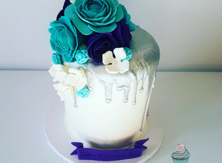 Silver drip cake with fondant flowers