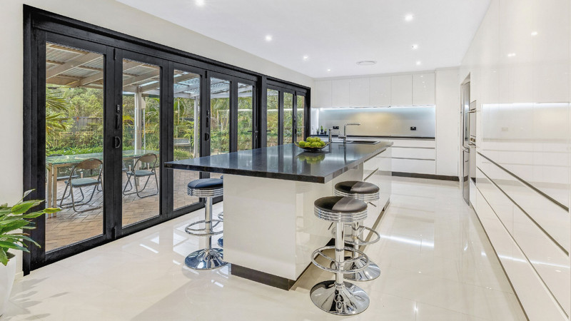 Two-Black-Bi-fold-Doors-separated-by-a-p
