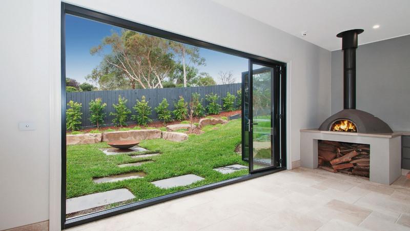 Black-Aluminium-Bi-fold-Doors-opening-to