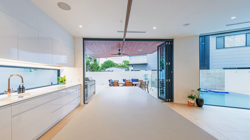 Blue-Bi-fold-Door-connecting-inside-and-
