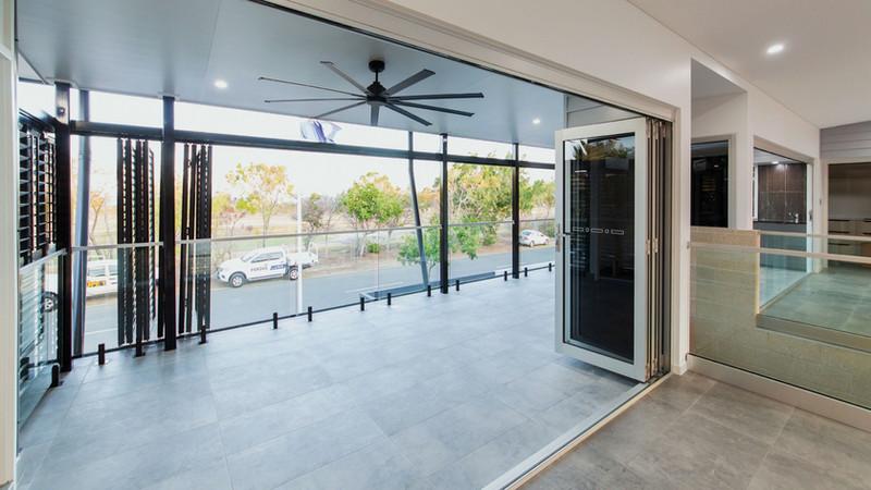 Aluminium-Bi-fold-Doors-with-grey-glass-