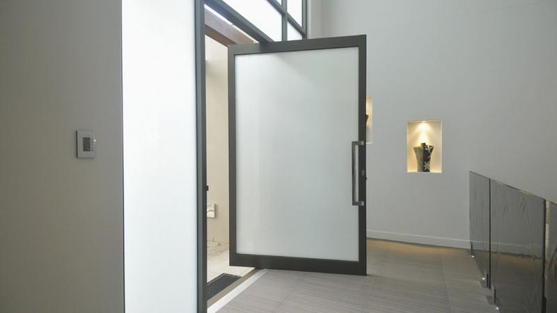 Black-Aluminium-Pivot-Door-with-obscure-