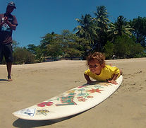 luz learning to surf on custom surfboard in tamarindo costa rica pedro's surf shop