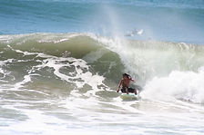 Pedro cruz surfing in tamarindo costa rica on big backside wave