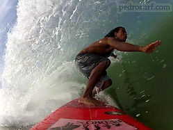 pedro cruz from pedro's surf shop duing a frontside barrel on monkey wrench surfboard in tamarindo costa rica