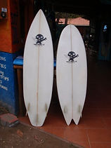 twin fin fish and classic shortboard with glassed on fins Custom monkey wrench surfboard from pedro's surf shop and school in tamarindo costa rica