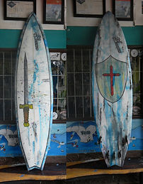 blue resin tint board with 5 fins and channels Custom monkey wrench surfboard from pedro's surf shop and school in tamarindo costa rica
