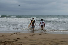 heading to water shortboard surf lesson during an advanced surf lesson in tamarindo costa rica