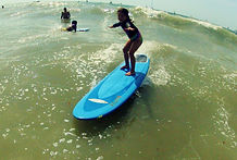 kids surf lesson at pedro's surf shop in tamarindo