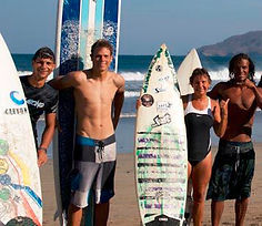 Richard lyons pedro cruz stafanie daly on the beach during surf lesson in tamarindo
