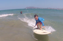 kids surf lesson at pedro's surf shop in tamarindo on shortboard ripping