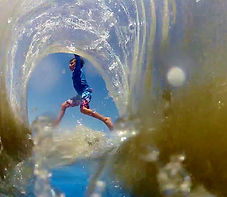 inside barrel little kids surf lesson at pedro's surf shop in tamarindo