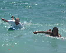 pedro cruz with student during an advanced surf lesson in tamarindo costa rica