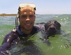 Richard lyons snorkeling with dog in tamarindo costa rica in front of pedro's surf shop
