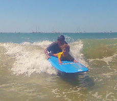 Pedro Cruz and Luz kids surf lesson at pedro's surf shop in tamarindo