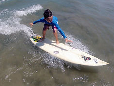 kids surf lesson with shortboard tamarindo costa rica