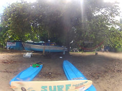 surf lessons in front of pedro's surf shop in tamarindo costa rica