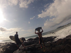 surf lesson in tamarindo costa rica richard lyon walking on rocks