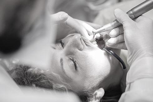 woman-s-teeth-being-clean-by-dentist-377