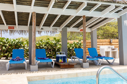 Gazebo with lounge beds by the pool.
