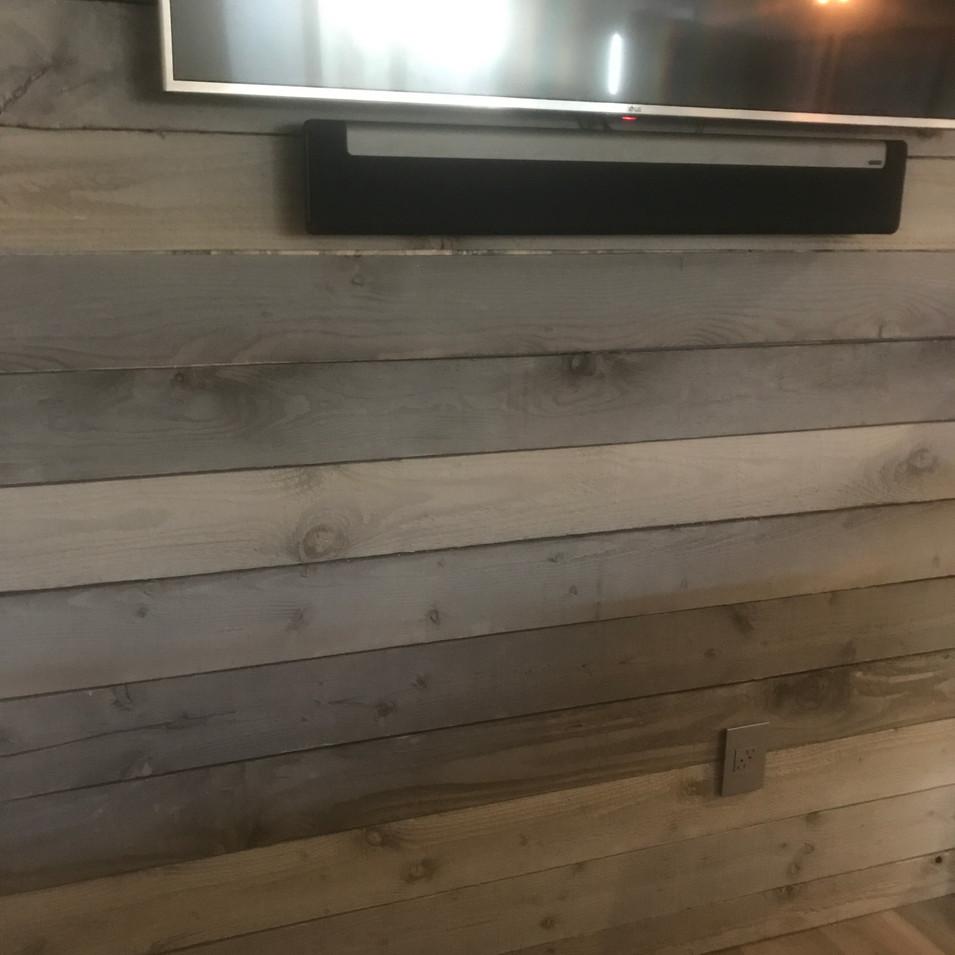 reclaimed wood wall.jpg