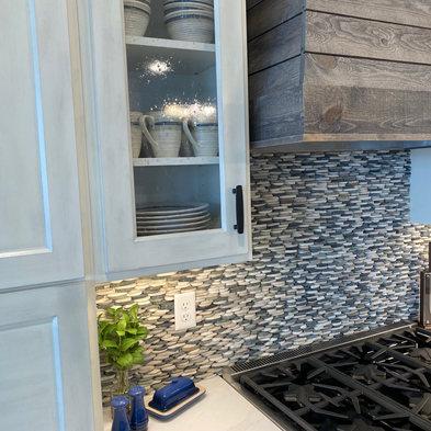 Whitewash Cabinets-Pebble Stone Backsplash-WoodRangeHood.jpg