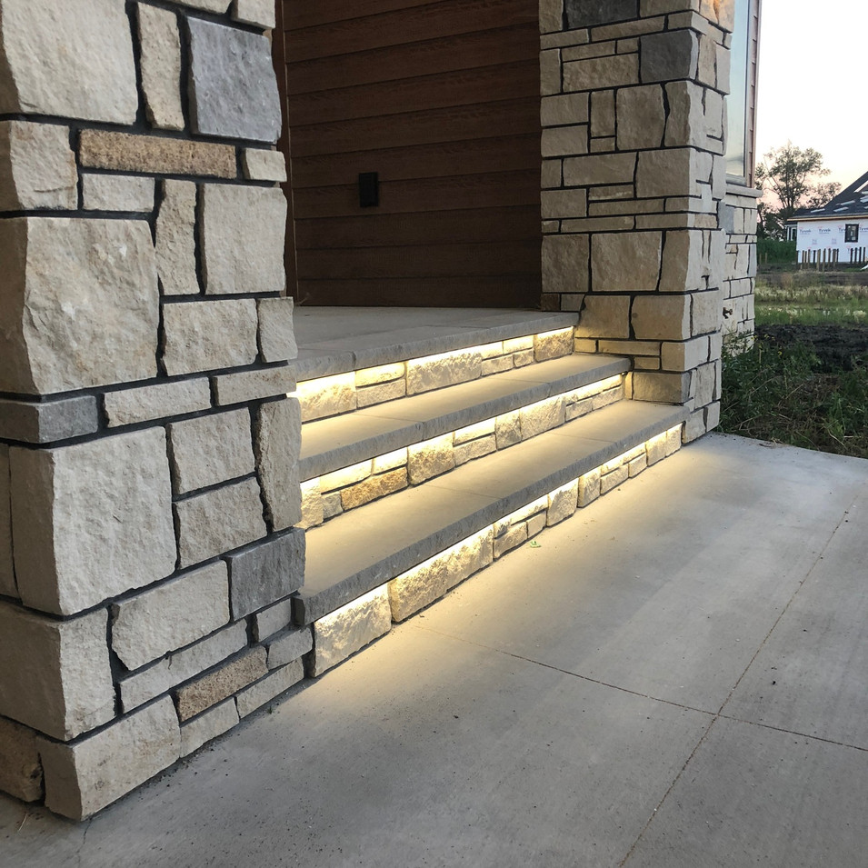 Stone Front Entry- lighted stair.JPG