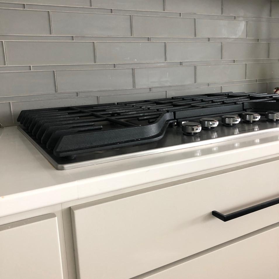 Gray Cabinets- GLass Backsplash.JPG