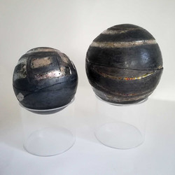 Two sphere boxes on perspex plinths