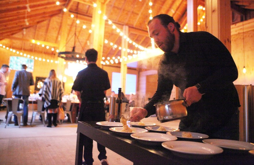 Biscuit and Pickles Catering's Dustin Joseph plates a course during a private event at the recently opened Hazelfern Cellars north of Newberg in April. // By Rockne Roll
