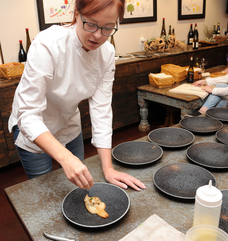 Norma begins the process of plating the the clams for the first course of the harvest dinner at Brooks.