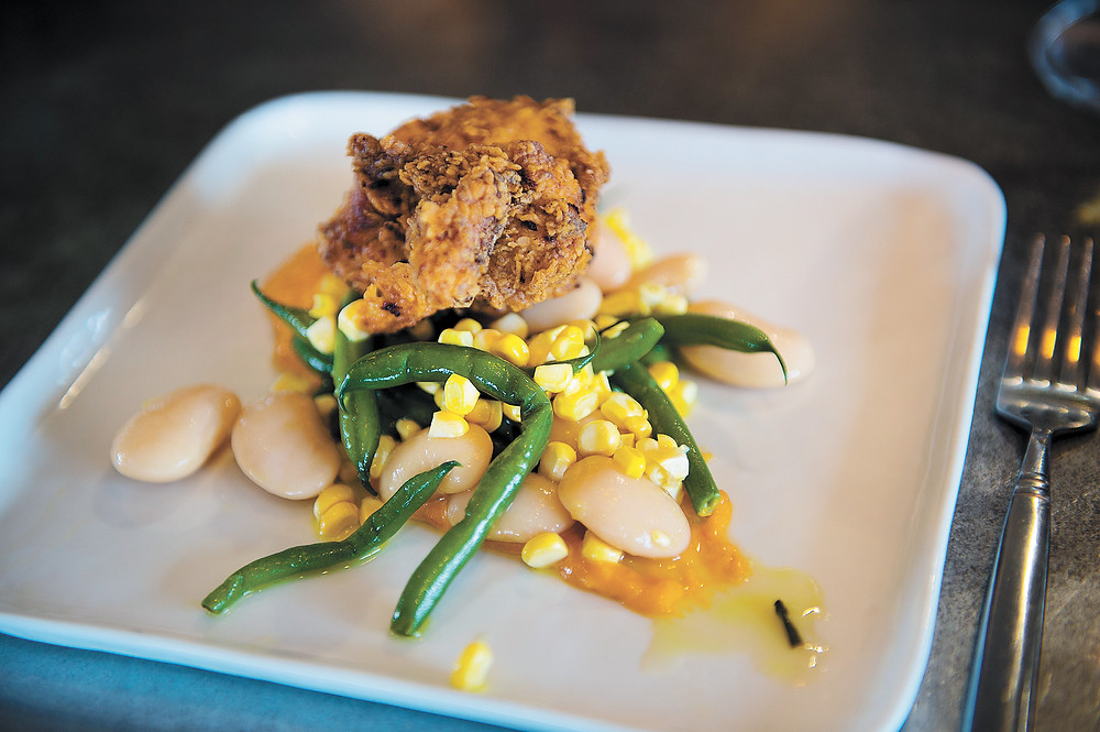 Buttermilk Fried Chicken with Carrona Bean Succotash and Sweet Pepper-Marcona Almond Sauce.