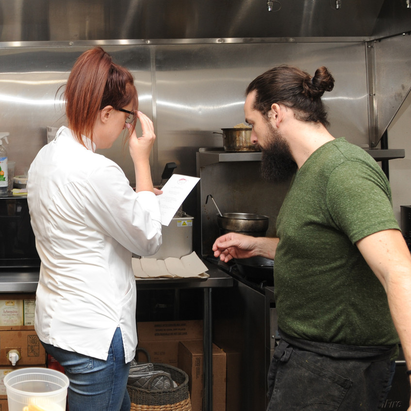 Norma and her assistant, Brent Cartier, review the menu for the evening's dinner, prior to starting work in the kitchen.