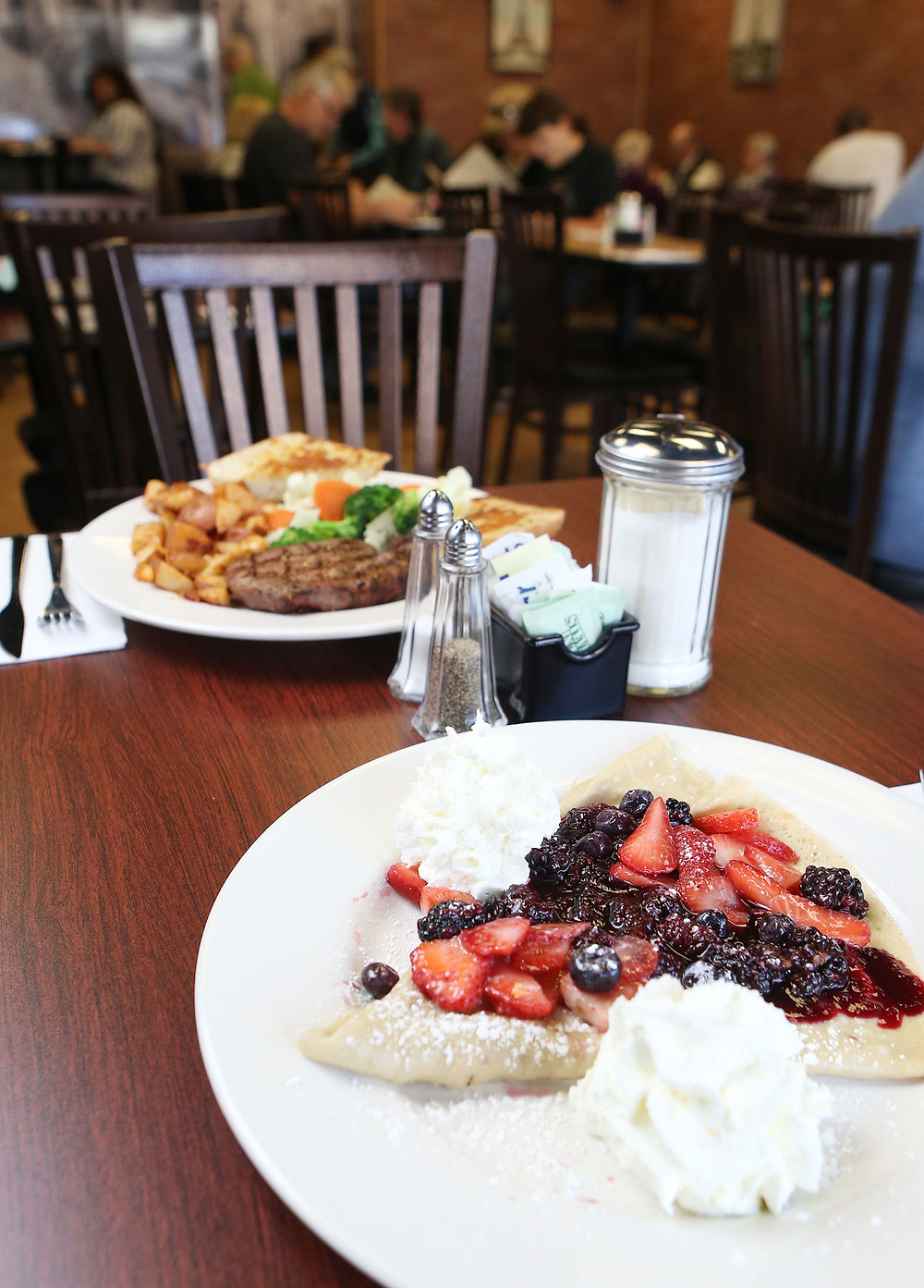 Berry crepes (foreground) and a steak dinner (back) at Eiffel Grill in McMinnville.