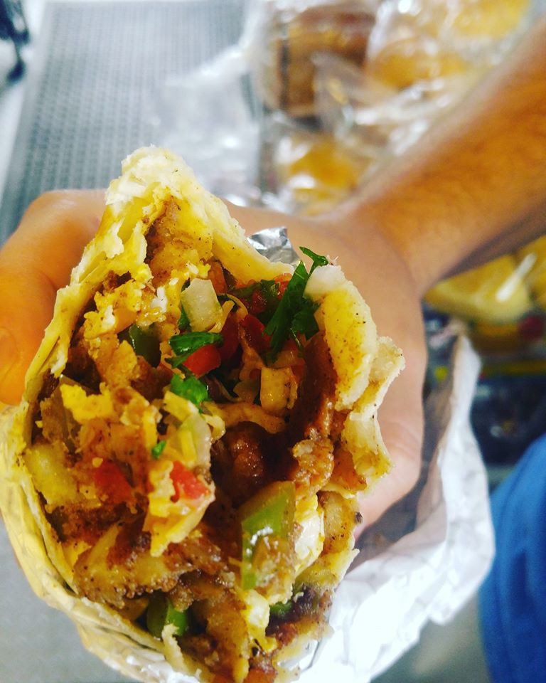 Vegan sausage(non gmo) local eggs from wooden mallet farms, potatoes, peppers and onions, Pico de gallo, cheese. / Courtesy Robin's Egg Food Cart