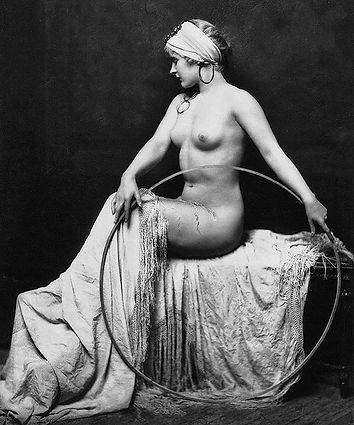 Old-time, black-and-white art photo of naked woman