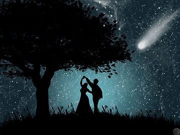 Couple in silhouette dances beneath the stars