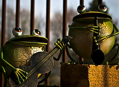 Two frog musicians