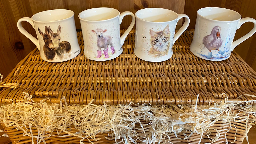 Set of four assorted 'Country Cuties' theme mugs