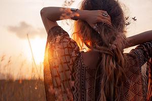 close up of beautiful young woman at sun