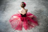 little ballerina red tutu sitting on flo