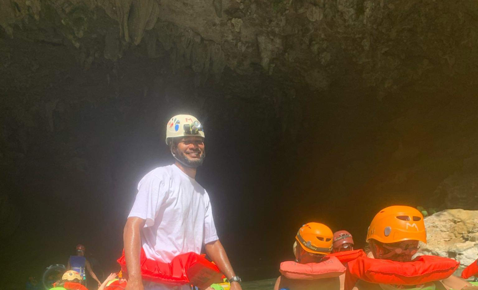 Tour guide, taking guests cave tubing